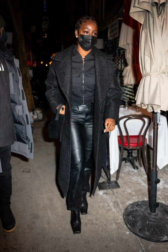 Justine Skye in a Black Coat