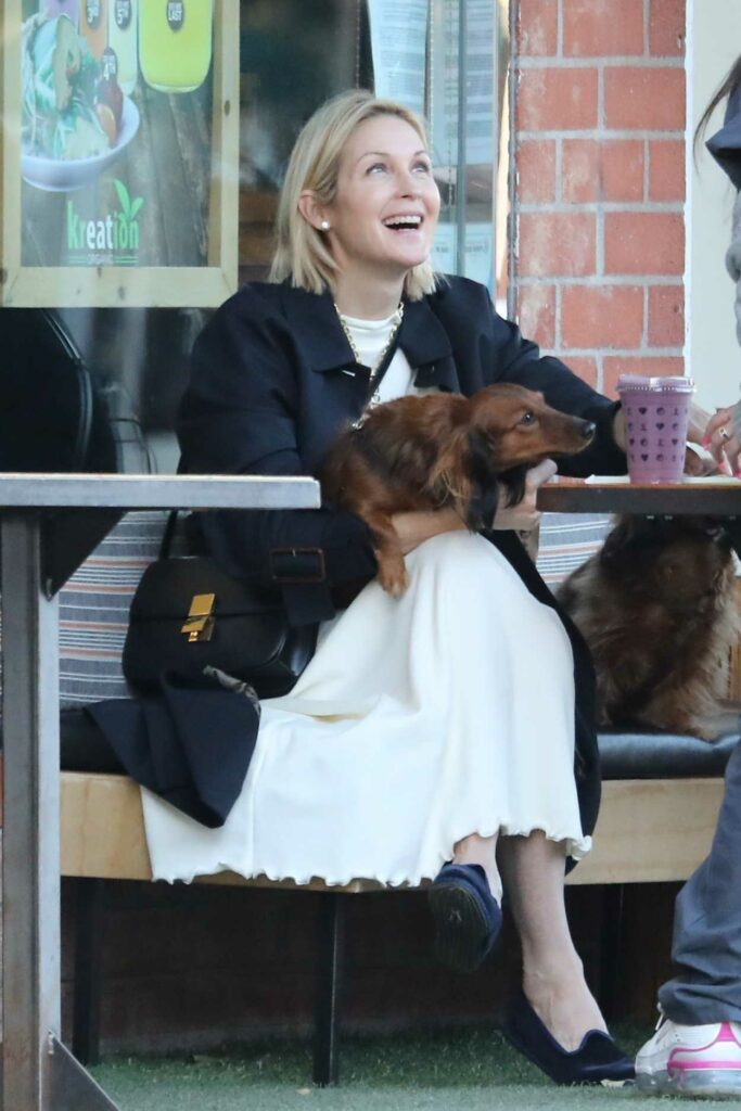 Kelly Rutherford in a White Dress