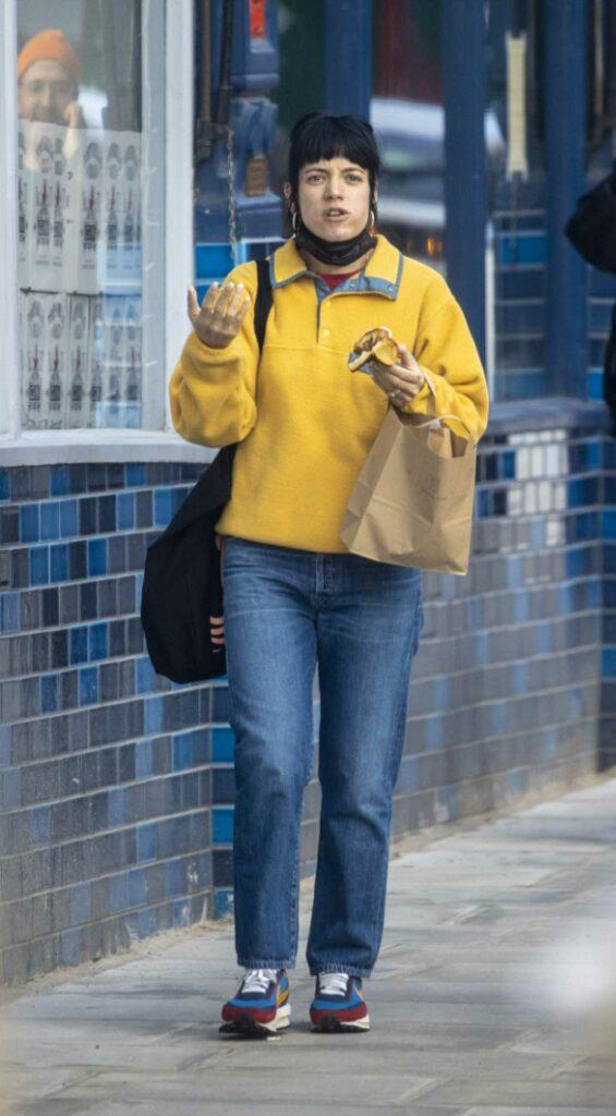Lily Allen in a Yellow Sweatshirt