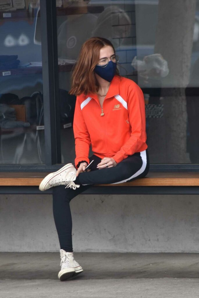 Zoey Deutch in a Red Track Jacket