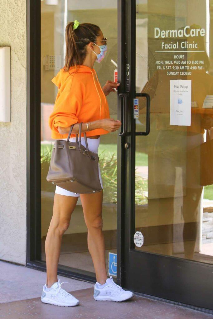 Alessandra Ambrosio in an Orange Hoodie