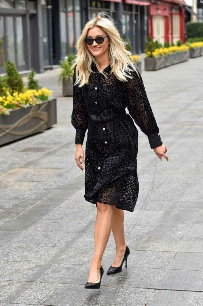 Ashley Roberts in a Black Animal Print Dress
