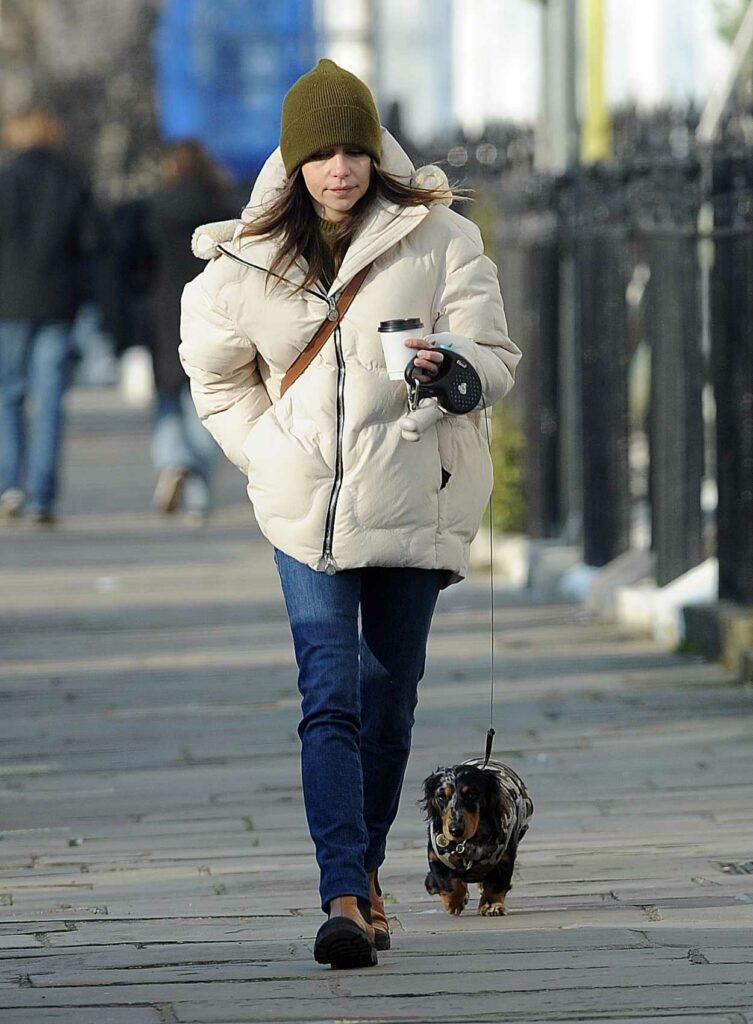 Emilia Clarke in a White Puffer Jacket