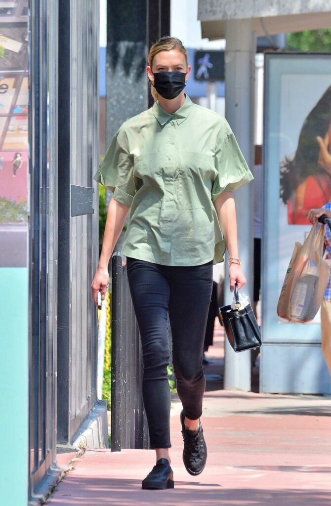 Karlie Kloss in an Olive Shirt