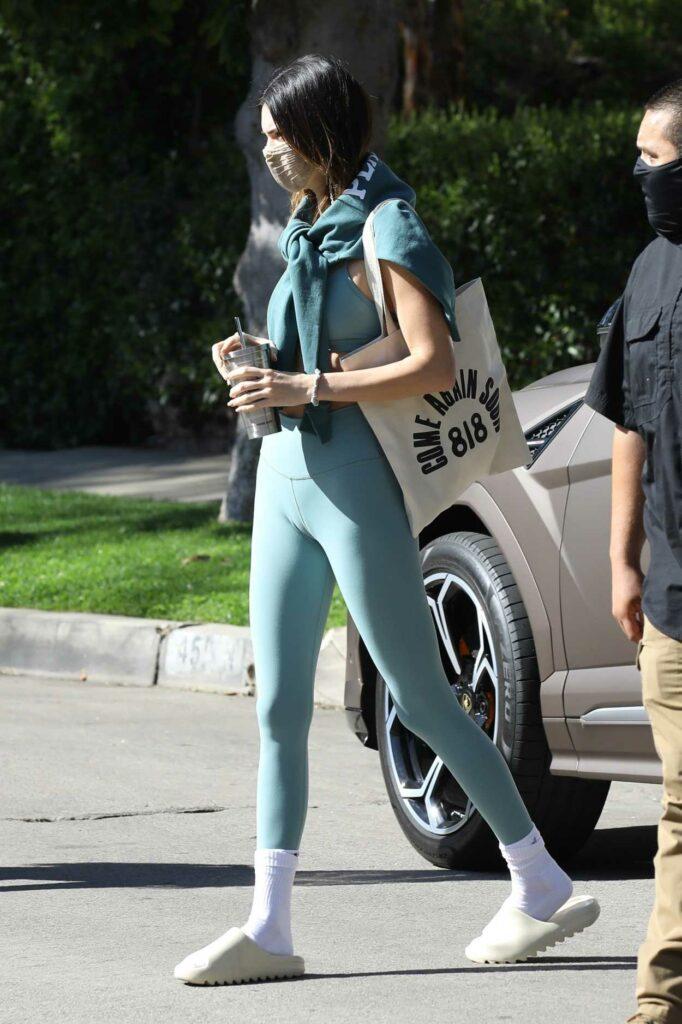 Kendall Jenner in a White Flip-Flops