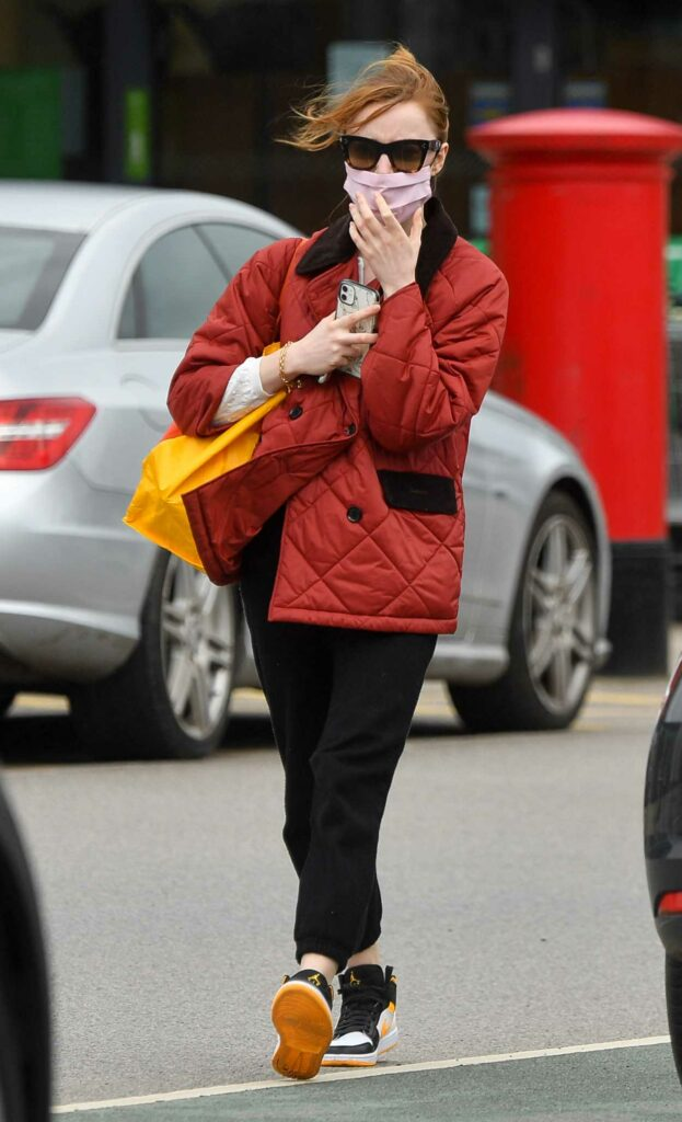 Phoebe Dynevor in a Red Jacket