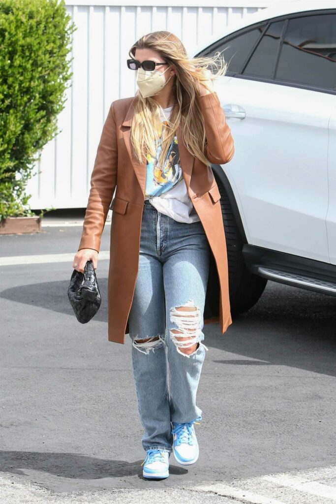 Sofia Richie in a Blue Ripped Jeans