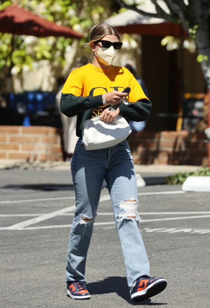 Sofia Richie in a Yellow and Black Sweater