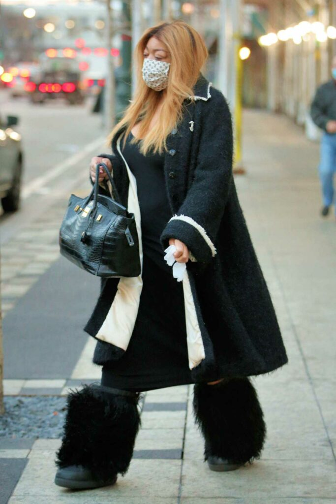 Wendy Williams in a Black Chanel Coat
