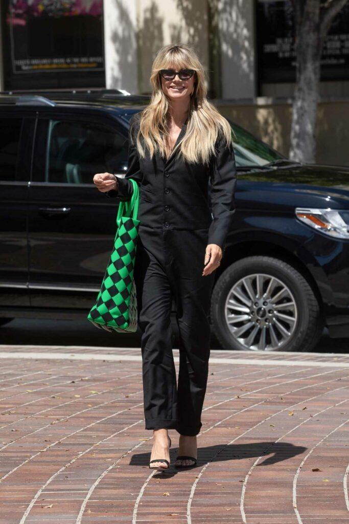 Heidi Klum in a Black Jumpsuit