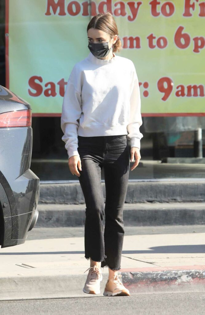 Lily Collins in a White Sweatshirt