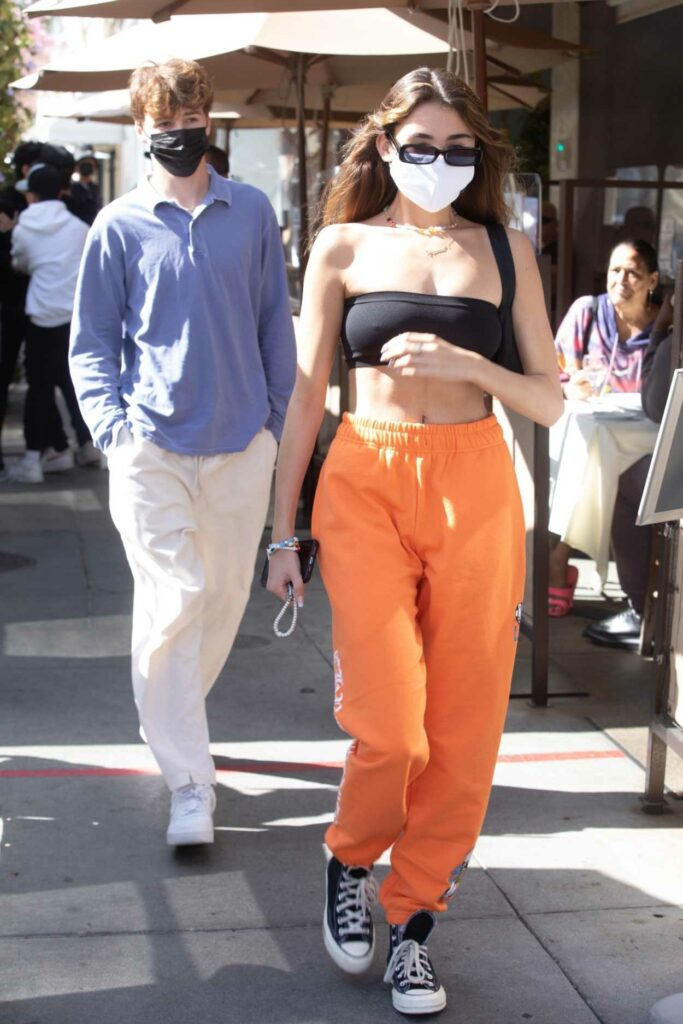 Madison Beer in an Orange Sweatpants
