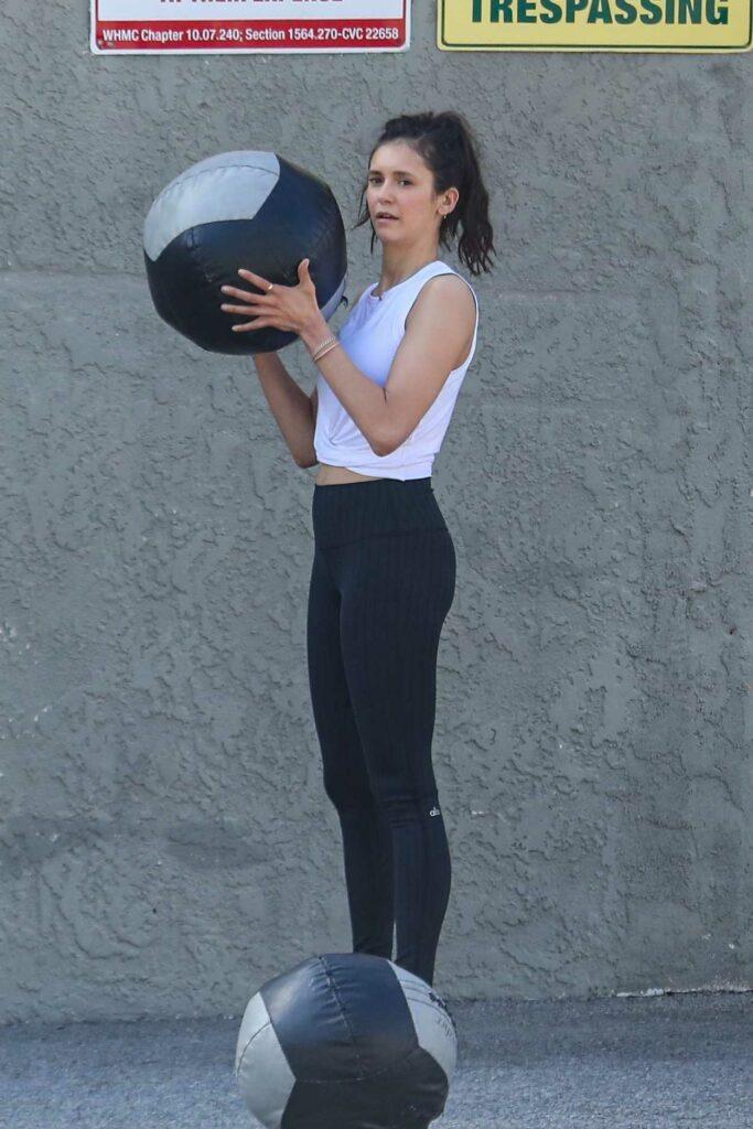 Nina Dobrev in a White Top