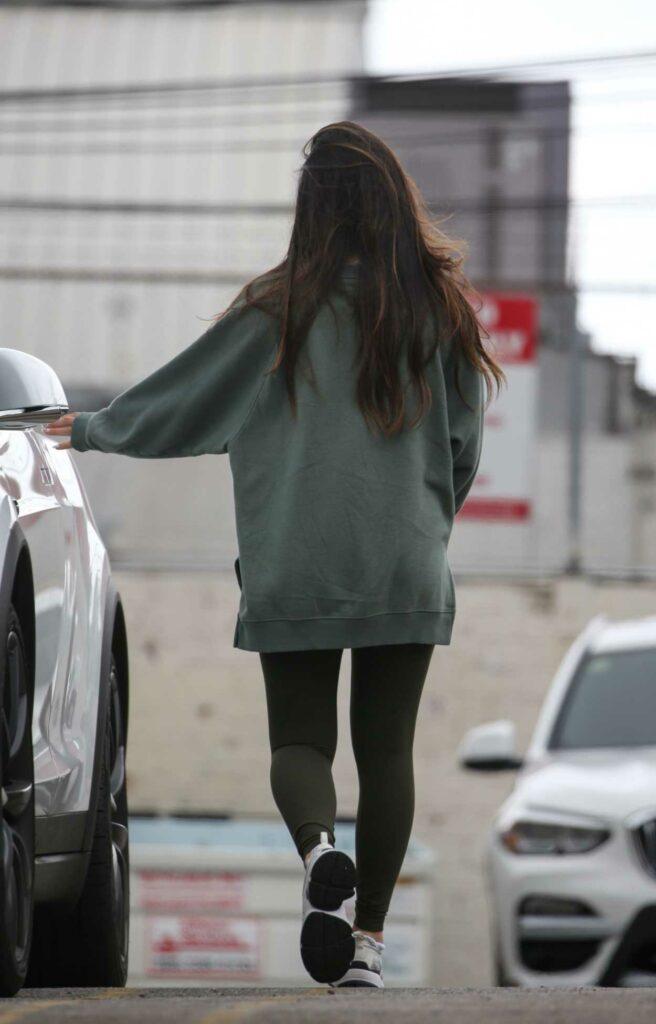 Olivia Munn in a Green Sweatshirt