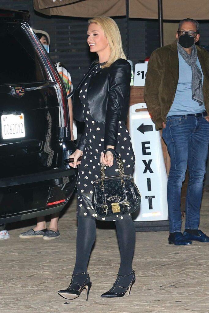 Paris Hilton in a Black Floral Mini Dress