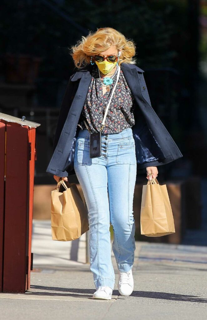 Busy Philipps in a Yellow Protective Mask