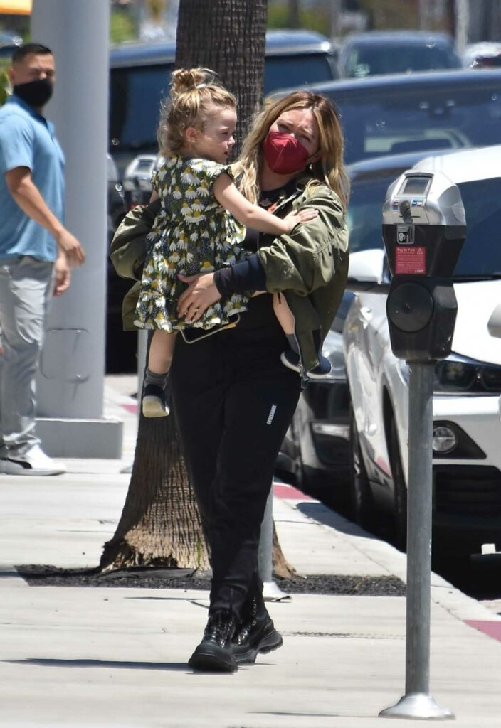 Hilary Duff in an Olive Bomber Jacket