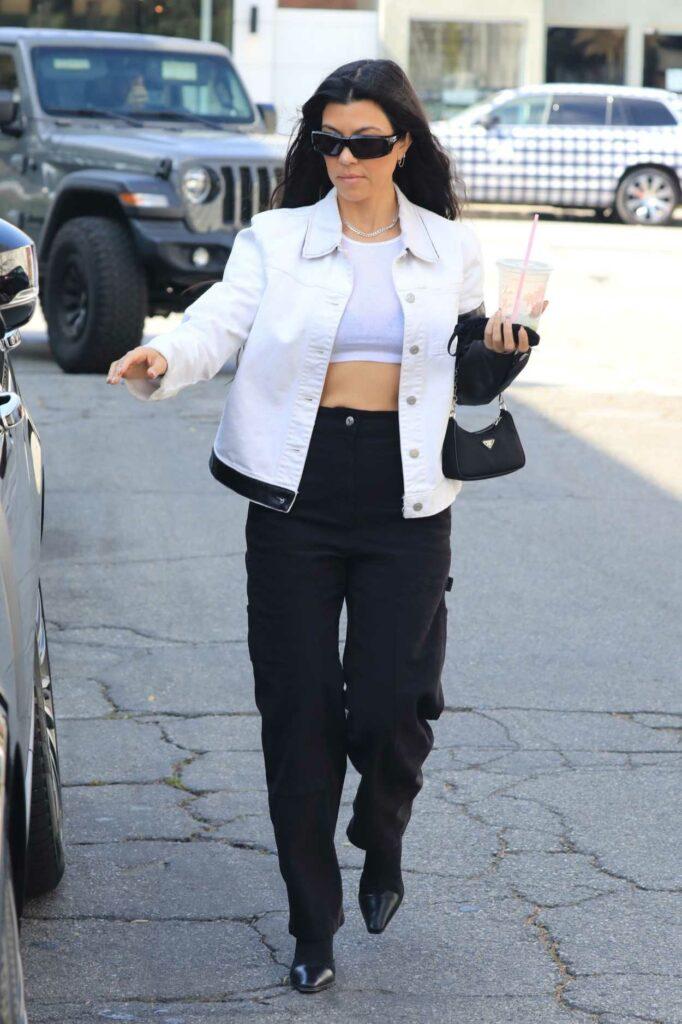Kourtney Kardashian in a White Jacket