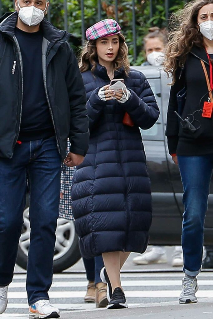 Lily Collins in a Black Puffer Coat