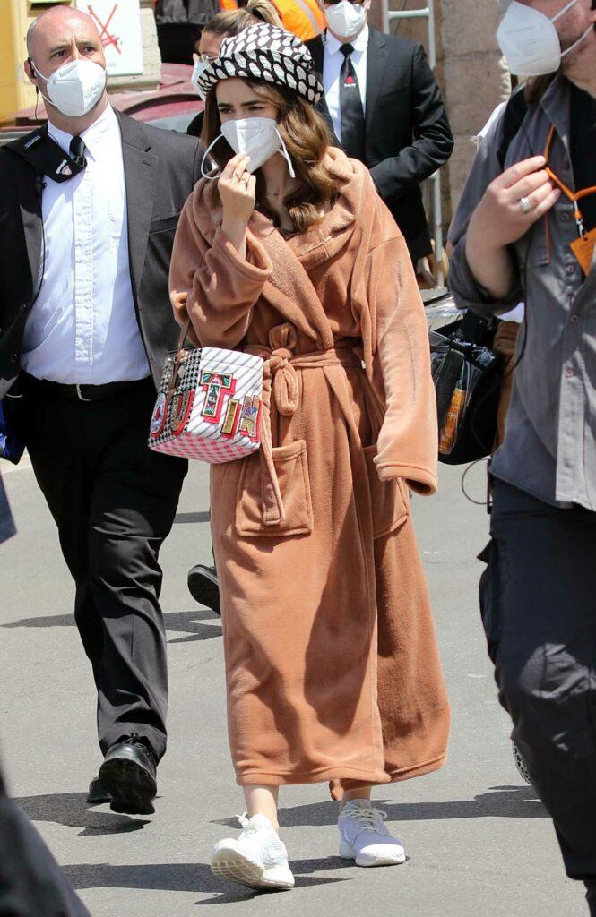 Lily Collins in a Tan Bathrobe