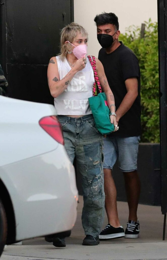 Miley Cyrus in a Pink Protective Mask