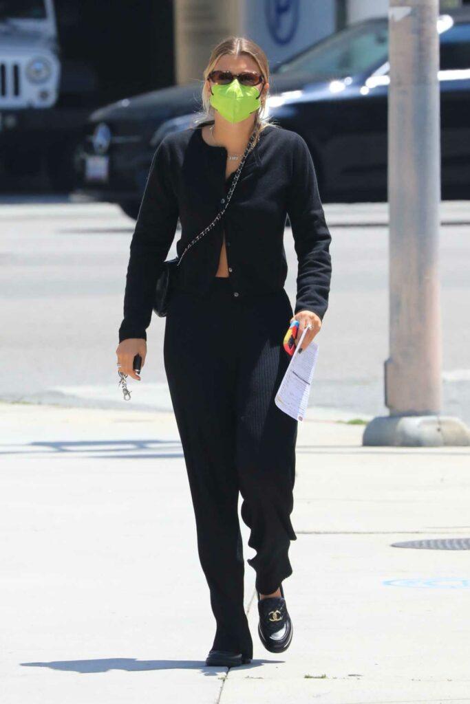 Sofia Richie in a Black Cardigan