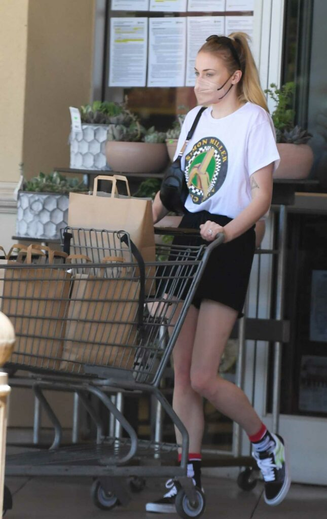 Sophie Turner in a White Tee