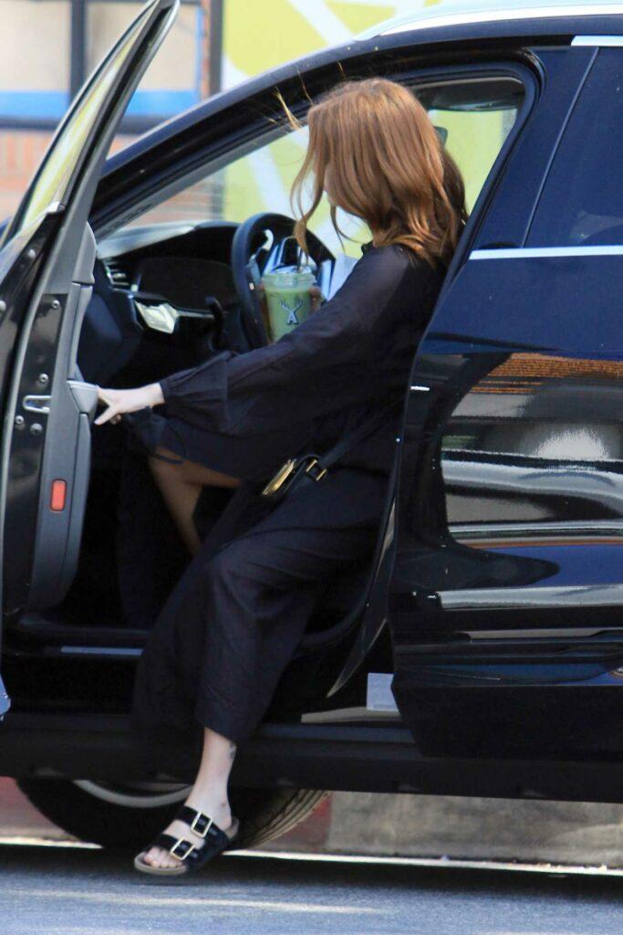 Zoey Deutch in a Black Dress