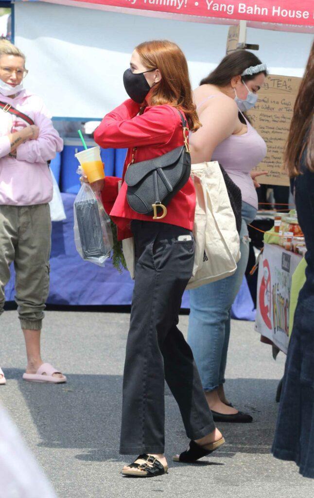 Zoey Deutch in a Red Jacket