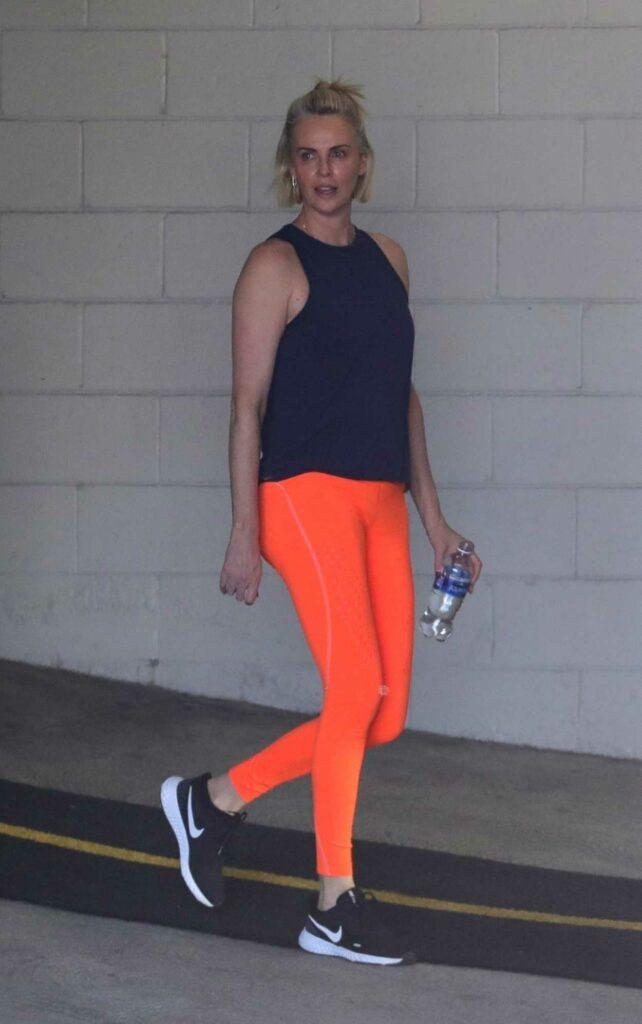 Charlize Theron in an Orange Leggings