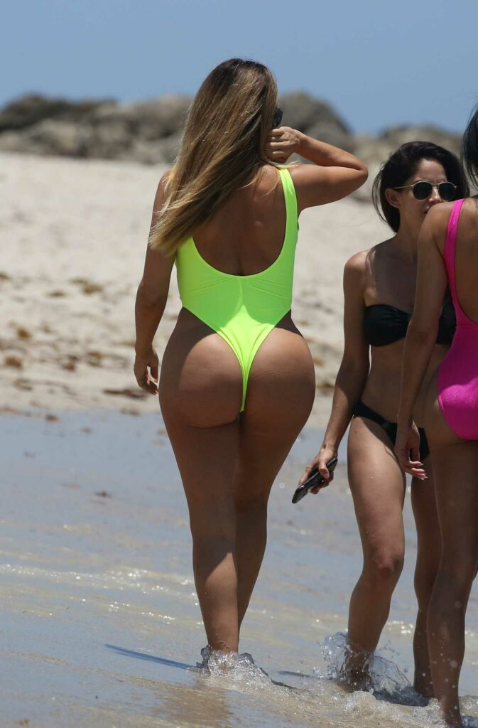 Larsa Pippen in a Neon Yellow Swimsuit