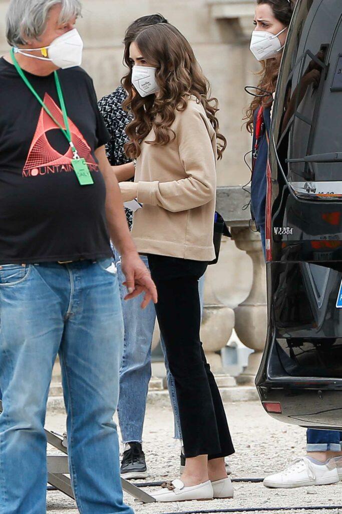 Lily Collins in a Beige Sweatshirt