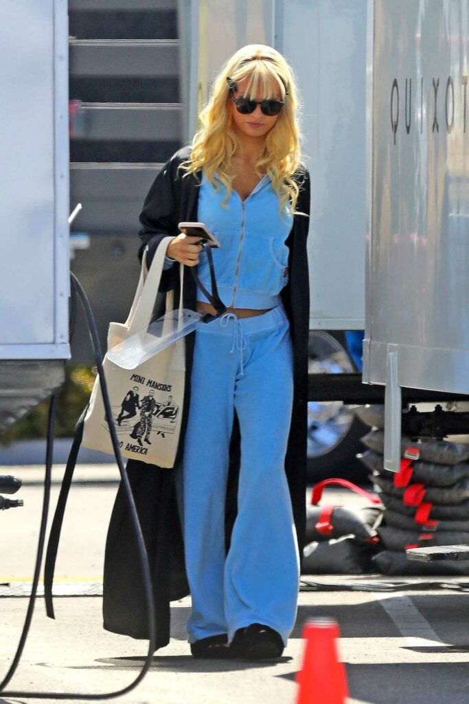 Lily James in a Blue Sweatsuit