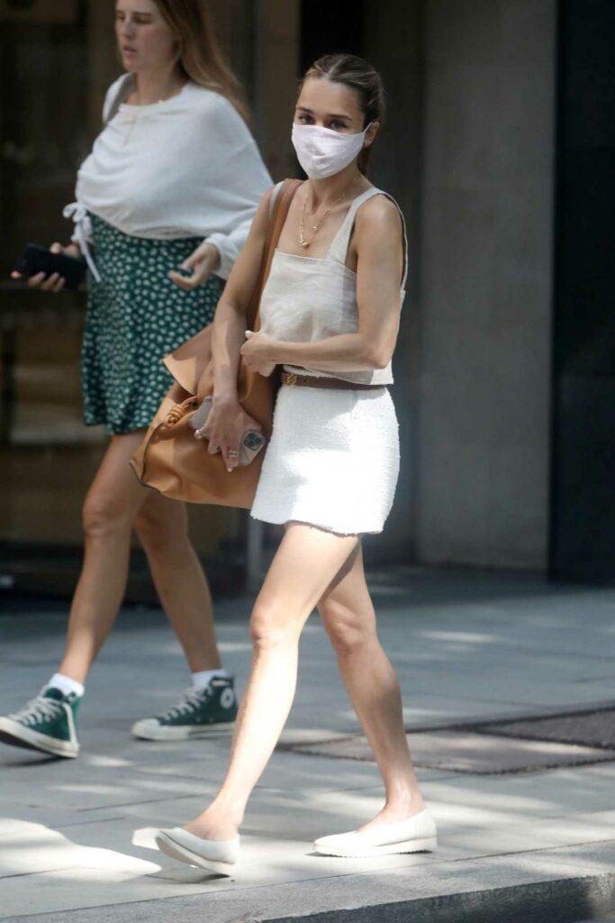 Emilia Clarke in a White Mini Skirt