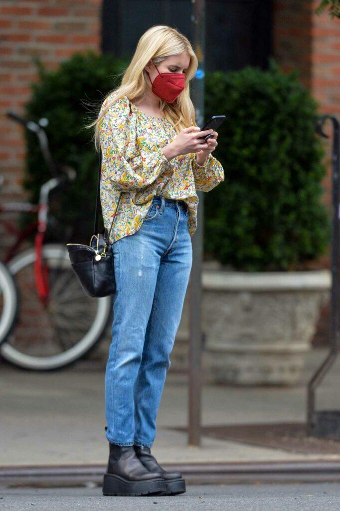 Emma Roberts in a Floral Blouse