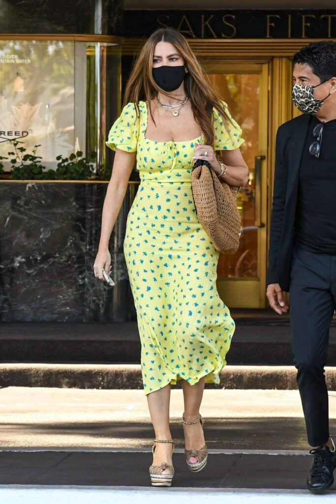 Sofia Vergara in a Yellow Patterned Dress