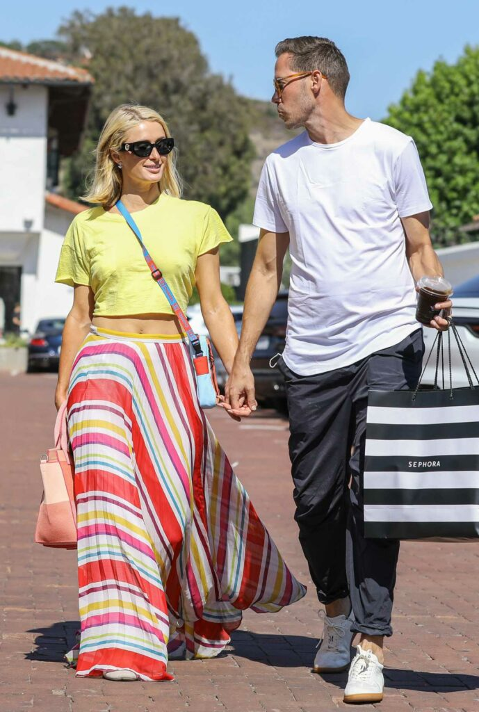 Paris Hilton in a Yellow Cropped Tee