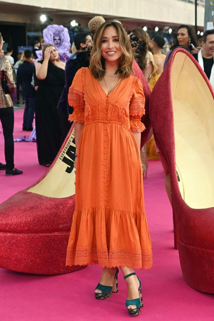 Myleene Klass in an Orange Dress