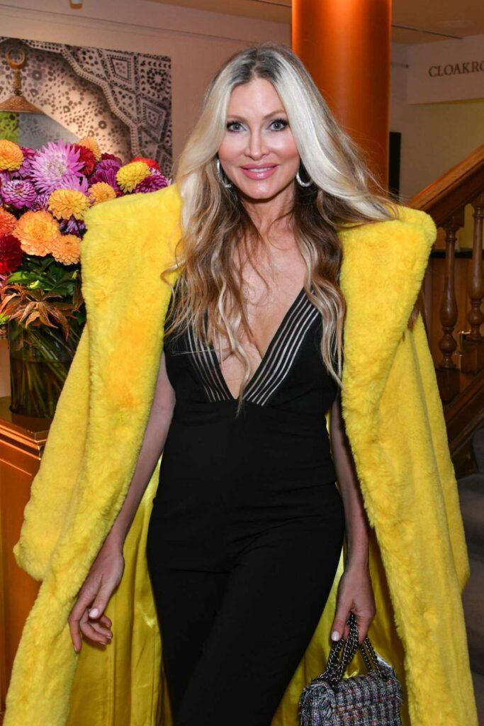 Caprice Bourret in a Yellow Fur Coat