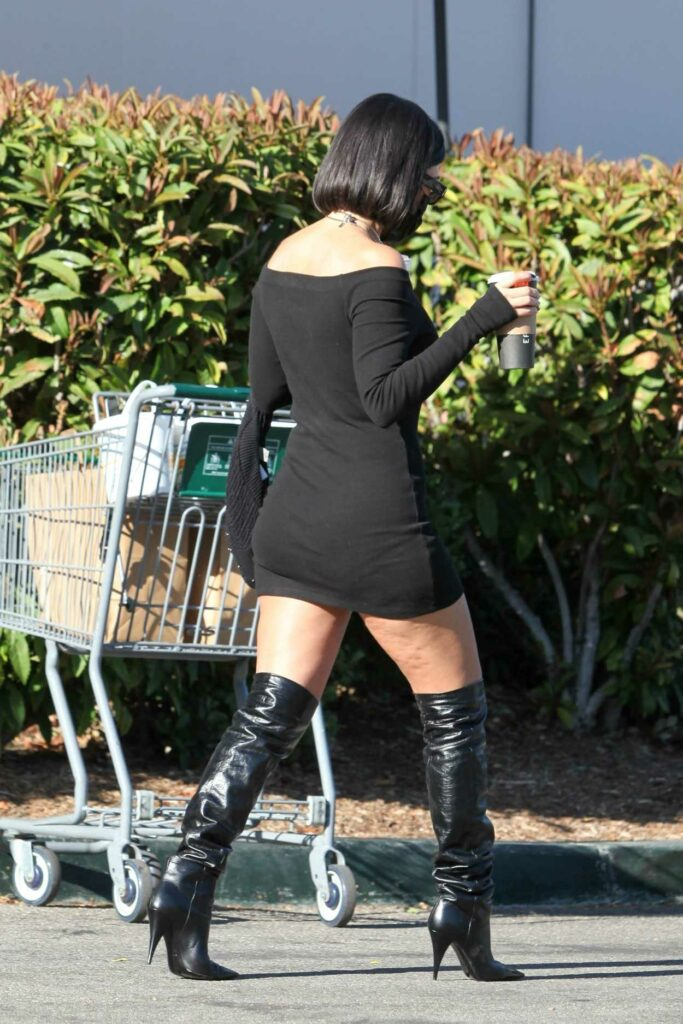 Kourtney Kardashian in a Black Dress
