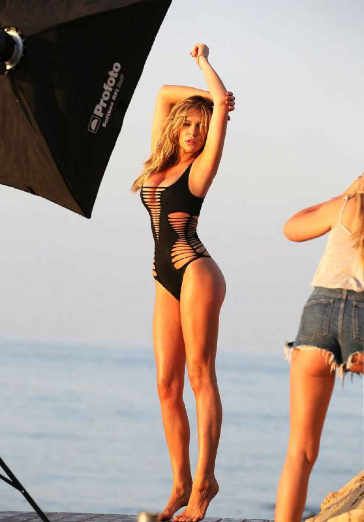 Abbey Clancy in a Black One-Piece Swimsuit - Photoshoot in Majorca, July 2015-1