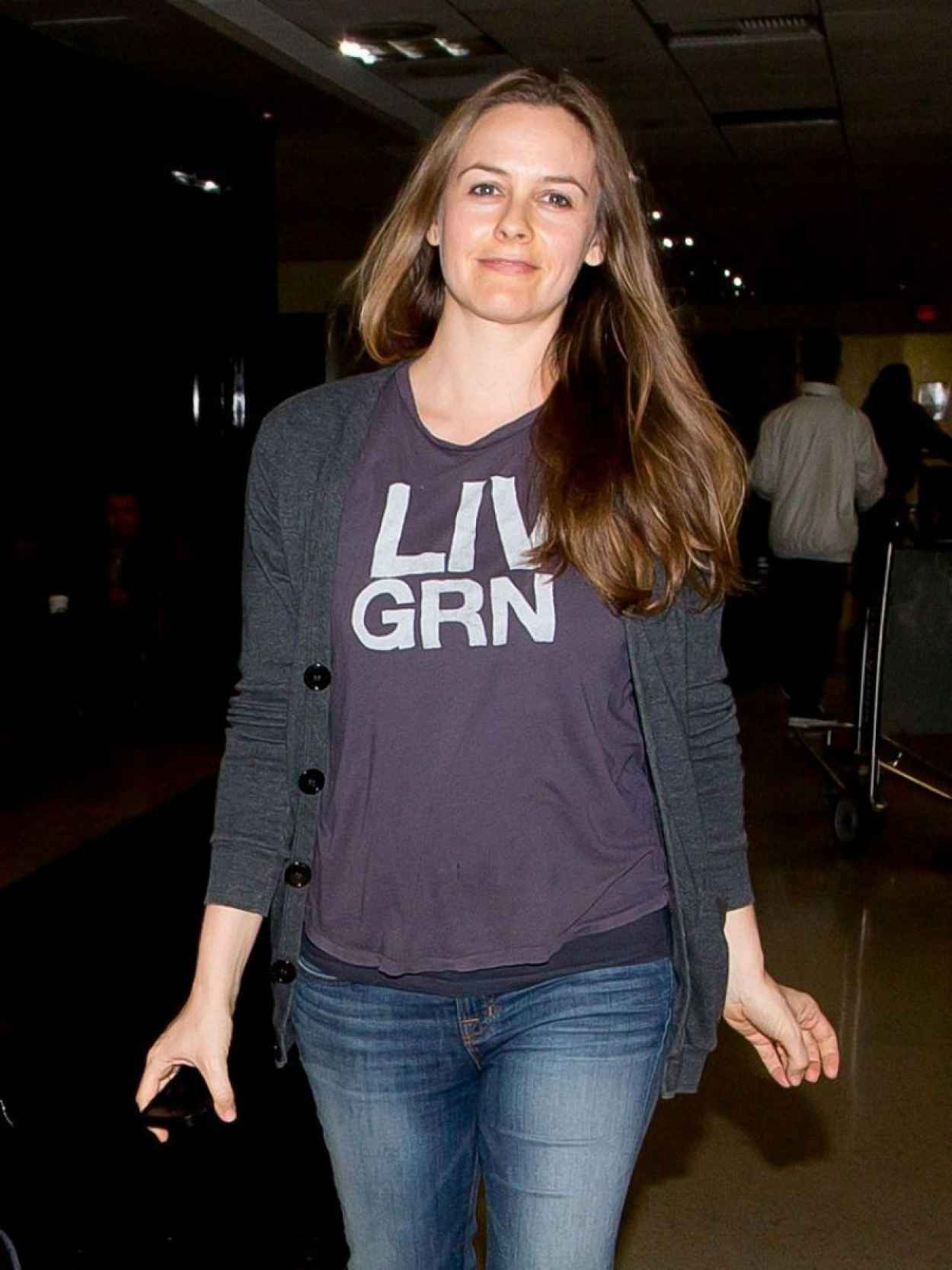 Alicia Silverstone in Jeans at LAX Airport - February 2015-2