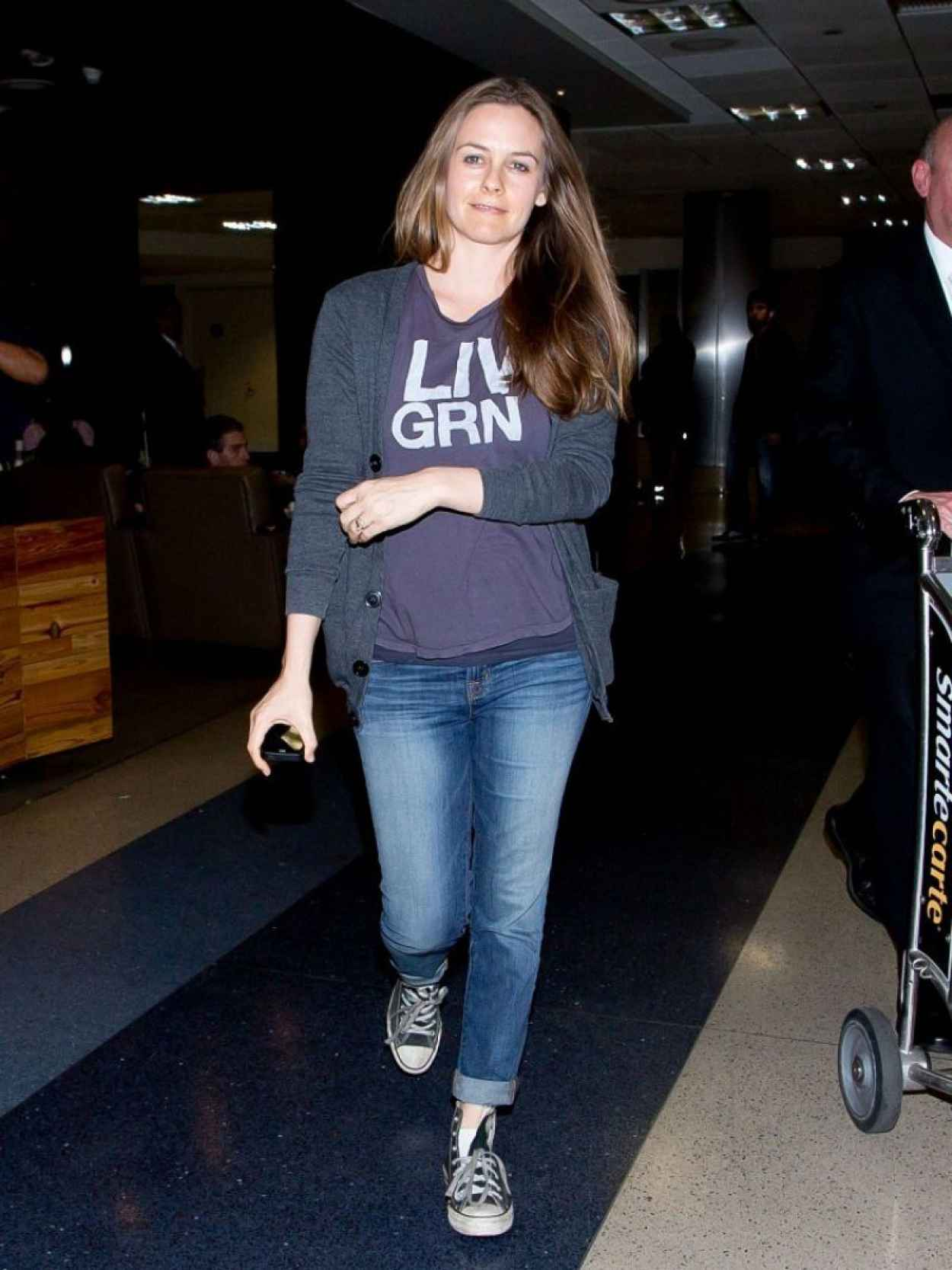 Alicia Silverstone in Jeans at LAX Airport - February 2015-4