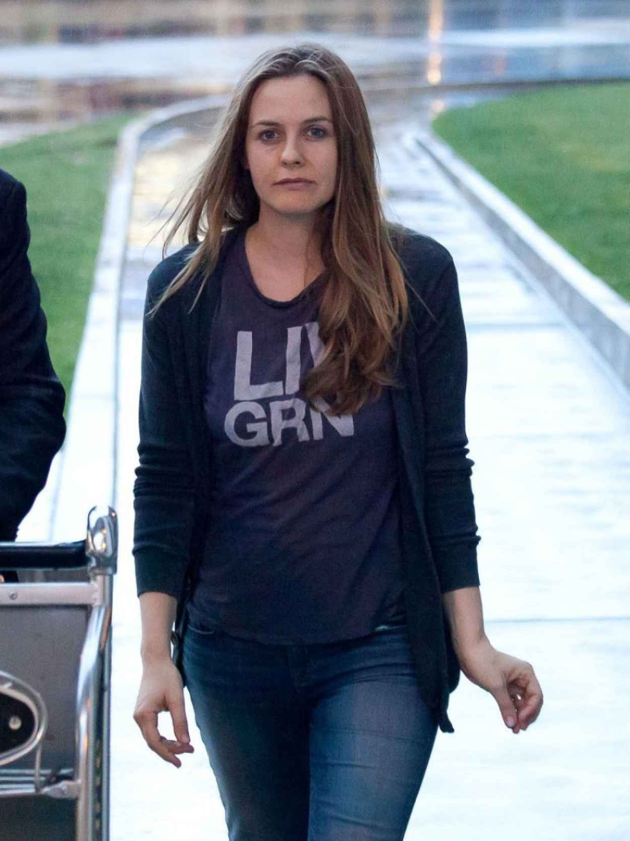 Alicia Silverstone in Jeans at LAX Airport - February 2015-5