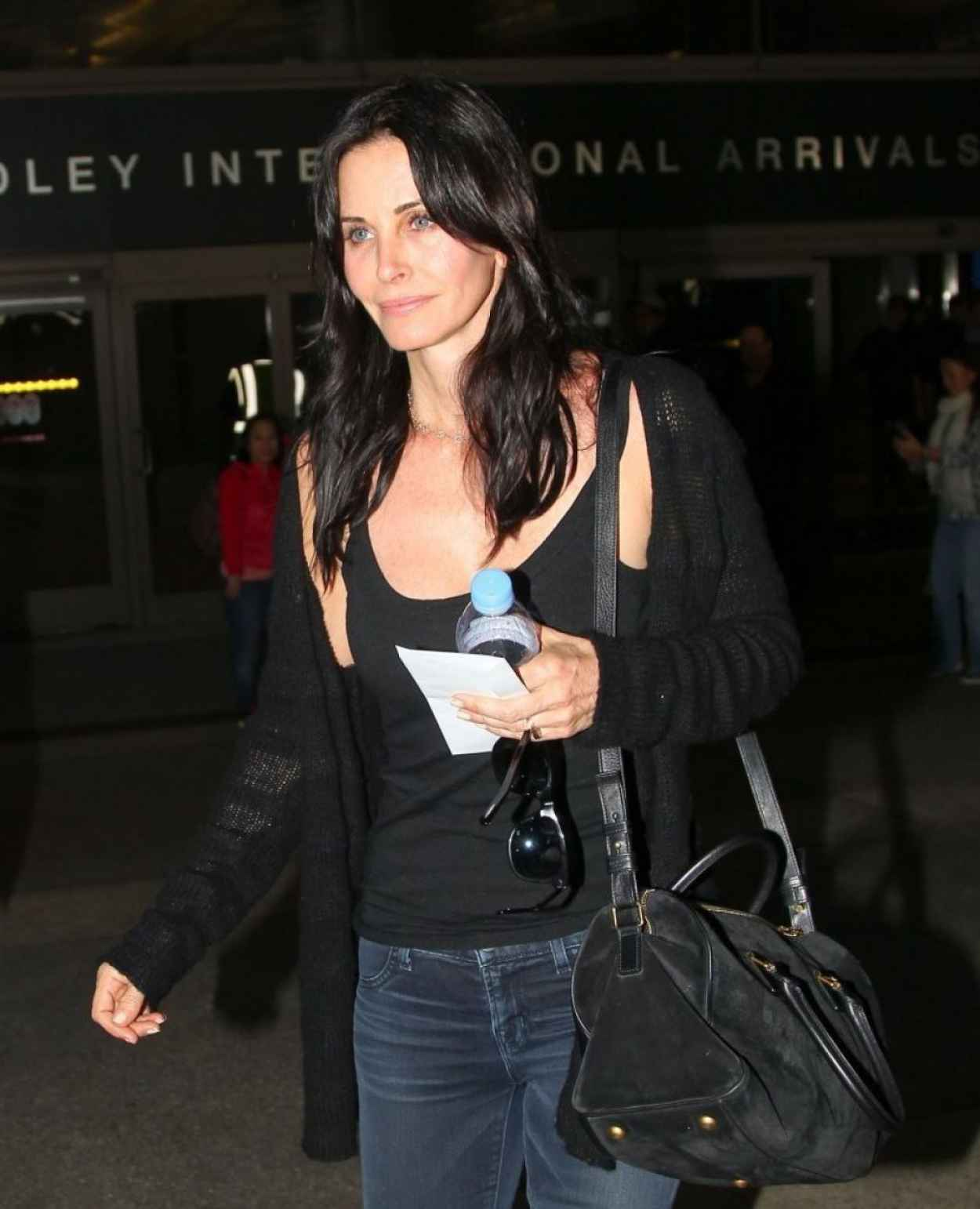 Courteney Cox in Jeans - At LAX Airport, Feb. 2015-1