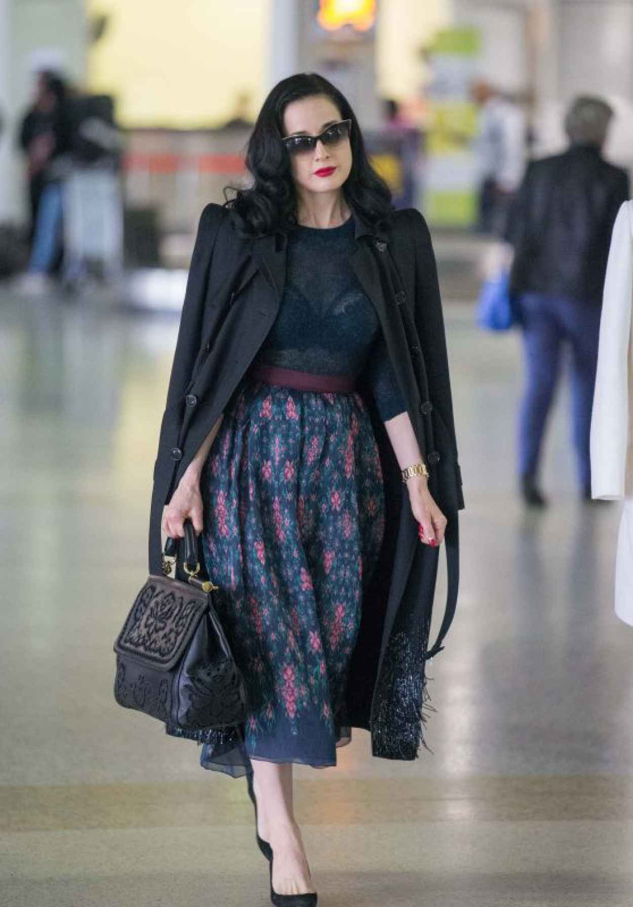 Dita Von Teese - Wearing Blue Top, Blue Skirt and a Large Black Coat - Melbourne Airport-1