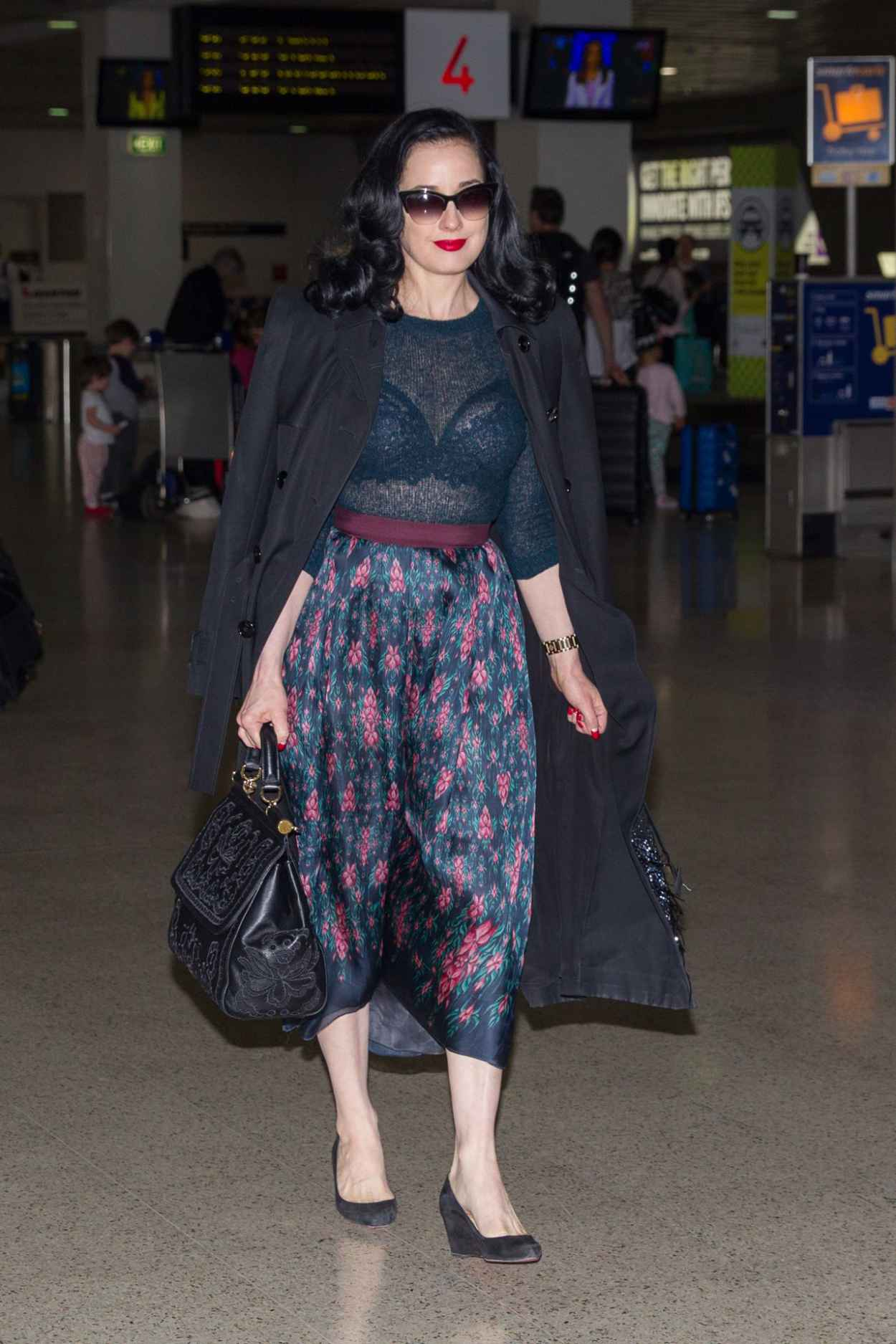 Dita Von Teese - Wearing Blue Top, Blue Skirt and a Large Black Coat - Melbourne Airport-2