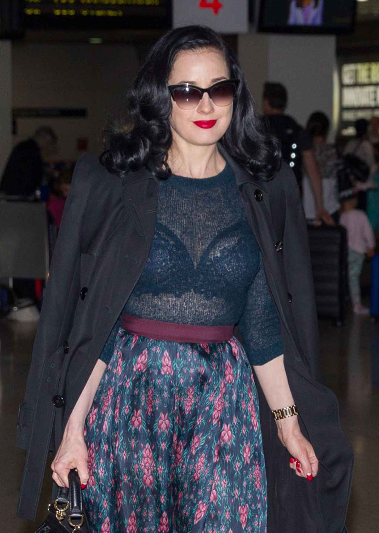 Dita Von Teese - Wearing Blue Top, Blue Skirt and a Large Black Coat - Melbourne Airport-3