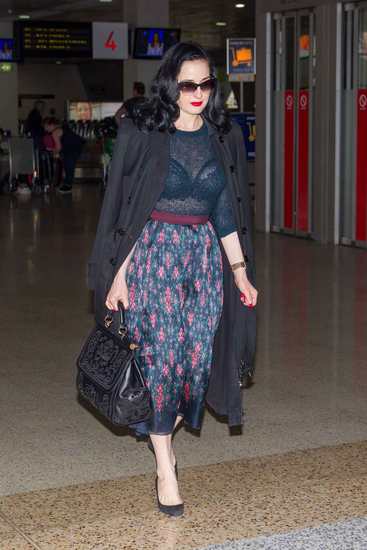 Dita Von Teese - Wearing Blue Top, Blue Skirt and a Large Black Coat - Melbourne Airport-4