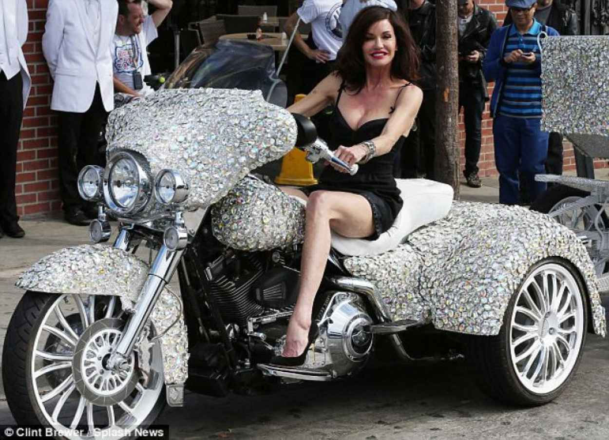 Janice Dickinson on a Three-Wheeled Motorcycle-1
